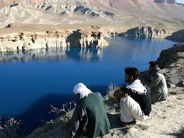 men at lake